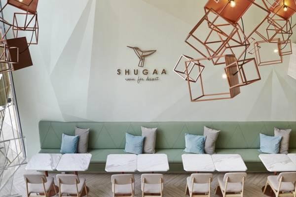 Уютный интерьер бара со сладостями SHUGAA